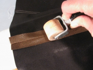Leather seam roller